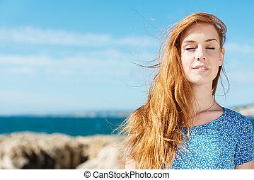Woman enjoying the peace of summer