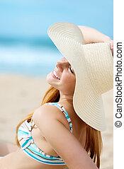 Woman Enjoying The Sun At The Beach