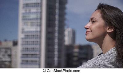 Woman enjoying the sun on rooftop