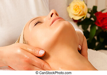 Woman enjoying wellness head massage