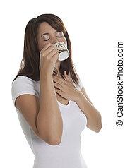 Woman enjoys a cup of espresso