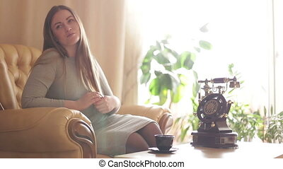 Woman enjoys fresh coffee in the morning with sunrise at home lifestyle.