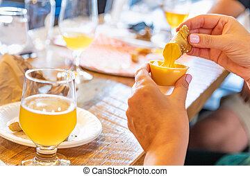 Woman Enjoys Warm Pretzels and Micro Brew Beer.