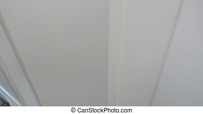 Woman entering by the door and going downstairs