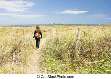 Woman entering in the pathway
