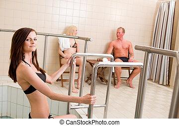 Woman Entering Pool in Spa