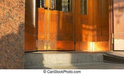 Woman Entering Swinging Doors