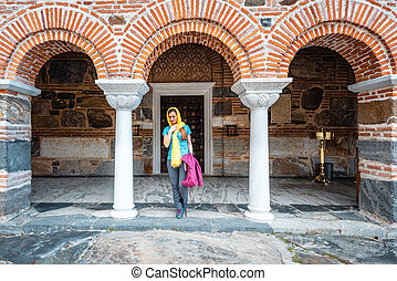 Woman entering the church on a Greek orthodox monastery