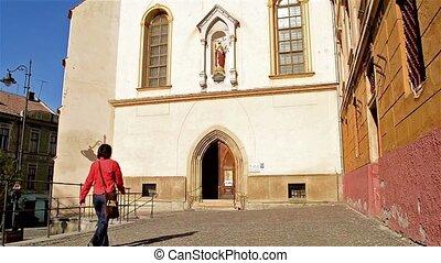 Woman Enters A Catholic Church