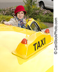Woman enters a Taxi