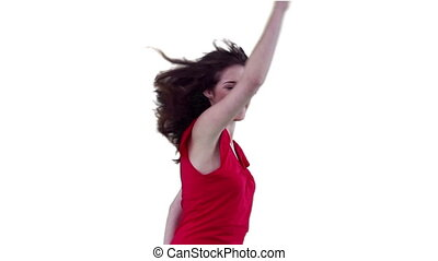 Woman enthusiastically jumping while flicking her hair