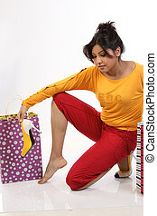 woman excited by shopping bags