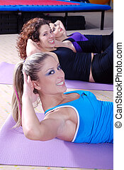 woman exercise in a fitness center - healthy woman exercise...