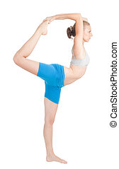 Woman exercise in flexibility standing in profile and holding leg with hands