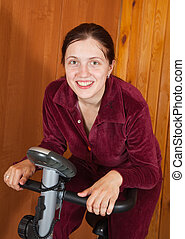 woman exercise on exercycle