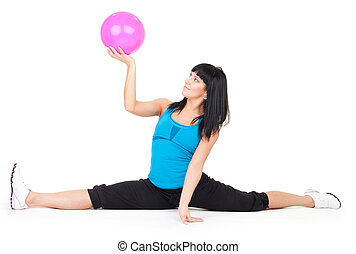 Woman exercise with ball doing splits