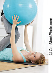 woman exercises at clean home