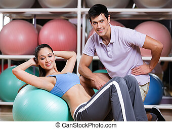 Woman exercises in fitness gym
