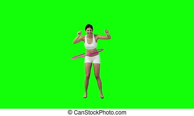 Woman exercises with a hula hoop