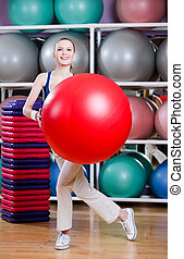 Woman exercises with gym ball