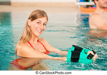 Aquarobics or hydrotherapy in spa - Woman exercising ...