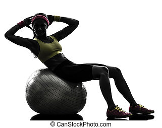 woman exercising crunches fitness ball workout silhouette