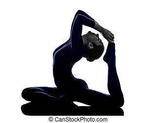sporty girl practicing eka pada rajakapotasana onelegged