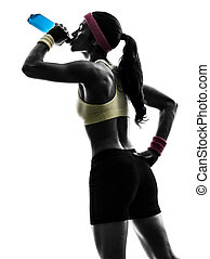 woman exercising fitness drinking energy drink silhouette