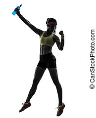woman exercising fitness holding energy drink  silhouette