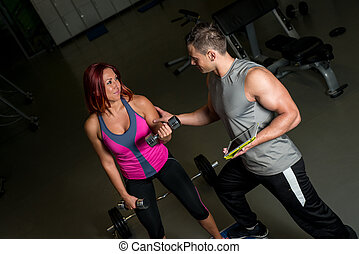 woman exercising fitness man coach using digital tablet