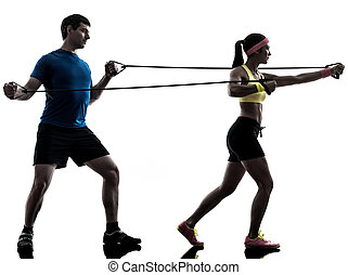 woman exercising fitness resistance rubber band with man...