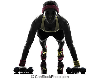woman exercising fitness workout push ups  silhouette
