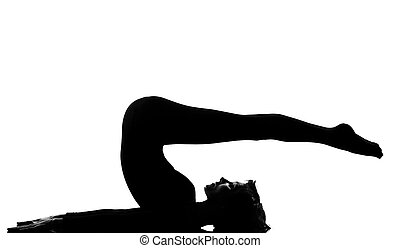 woman exercising lying on back fitness yoga stretching in shadow grayscale silhouette full length in studio isolated white background