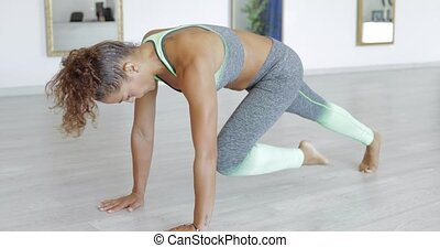 Woman exercising in class - Side view of black woman in...