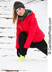 Woman exercising legs outside during winter