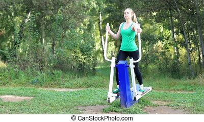 Woman exercising on a trainer