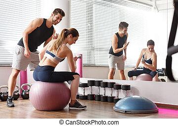 Woman exercising on ball