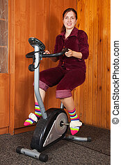 woman exercising on exercise bike