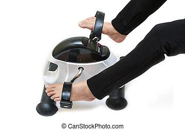 Woman exercising on exercise bike , Upper / Lower body rehab...