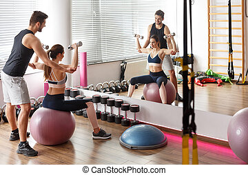 Woman exercising on gym ball