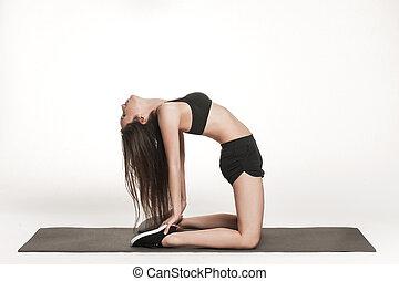 Woman exercising on man