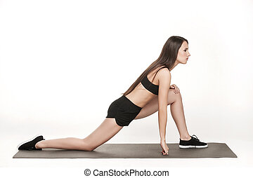 Woman exercising on man
