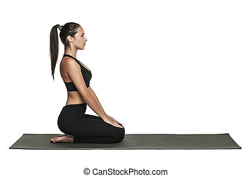 Woman exercising on yoga mat. Isolated on white.