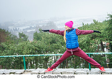 Woman exercising outside during autumn
