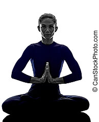 woman exercising Padmasana lotus pose yoga silhouette