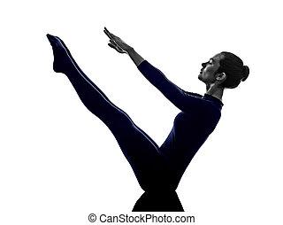 woman exercising paripurna navasana boat pose yoga silhouette