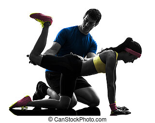 woman exercising plank position fitness workout with man...