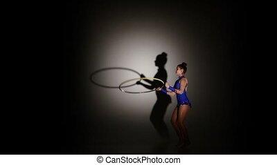 woman exercising Rhythmic Gymnastics hula hoop, slow motion...
