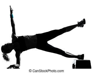 woman exercising step aerobics