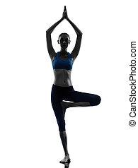 woman exercising tree pose yoga